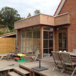 uitbouw - hout - ramen - plat dak